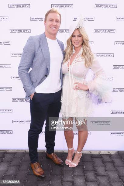 Player Kroy Biermann and TV Personality Kim Zolciak attend as Kim Zolciak hosts the Kentucky Derby hat contest at Empire City Casino at Yonkers...