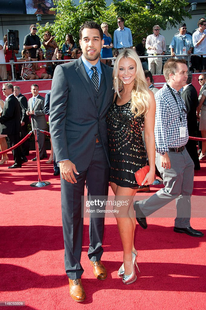 NBA player <a gi-track='captionPersonalityLinkClicked' href=/galleries/search?phrase=Landry+Fields&family=editorial&specificpeople=4184645 ng-click='$event.stopPropagation()'>Landry Fields</a> of the New York Knicks and a guest arrive at the 2012 ESPY Awards at Nokia Theatre L.A. Live on July 11, 2012 in Los Angeles, California.
