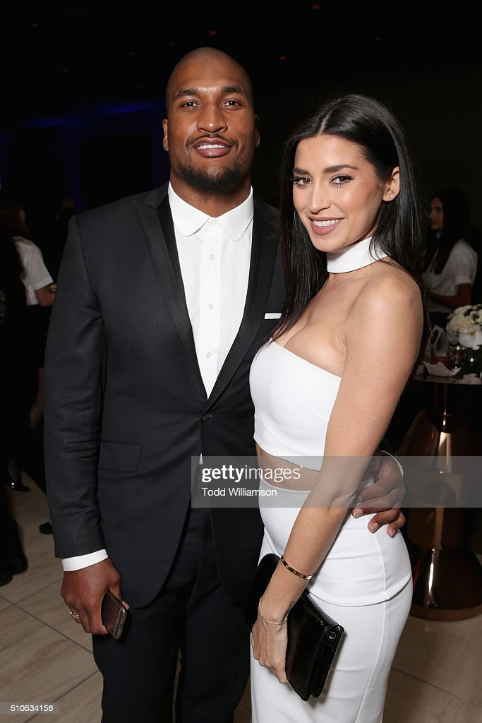 Player Larry English and model Nicole Williams attend Warner Music Groups' annual Grammy celebration at Milk Studios Los Angeles on February 15 2016...