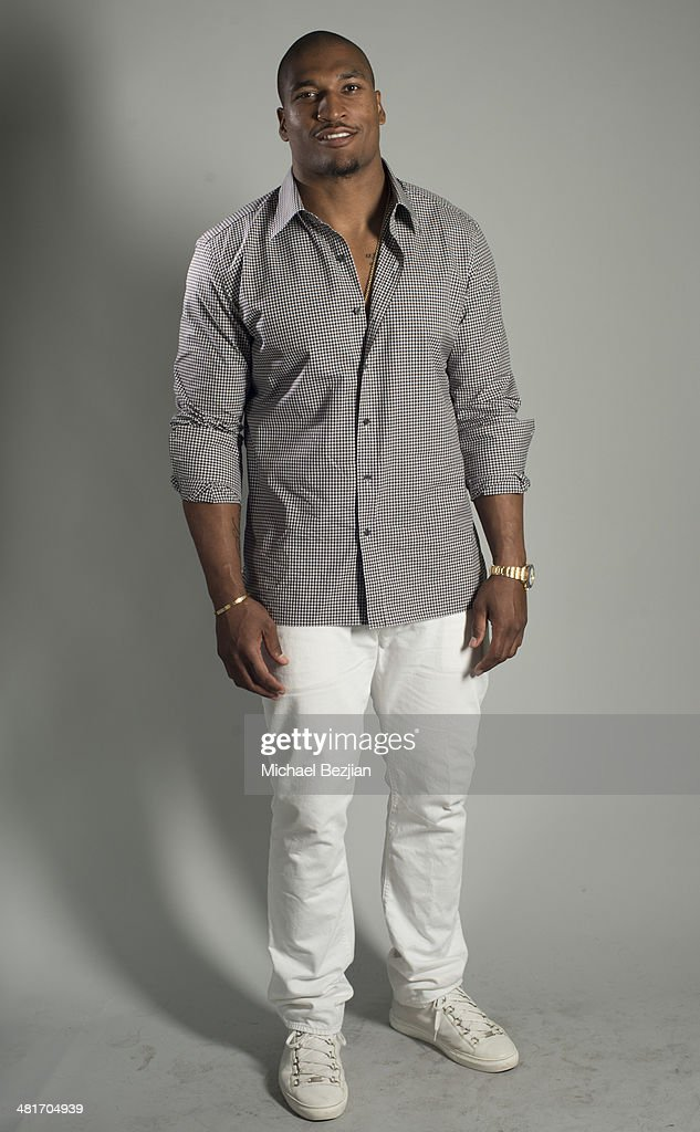 Player Larry English poses for Portraits For Pooches on March 30 2014 in Beverly Hills California