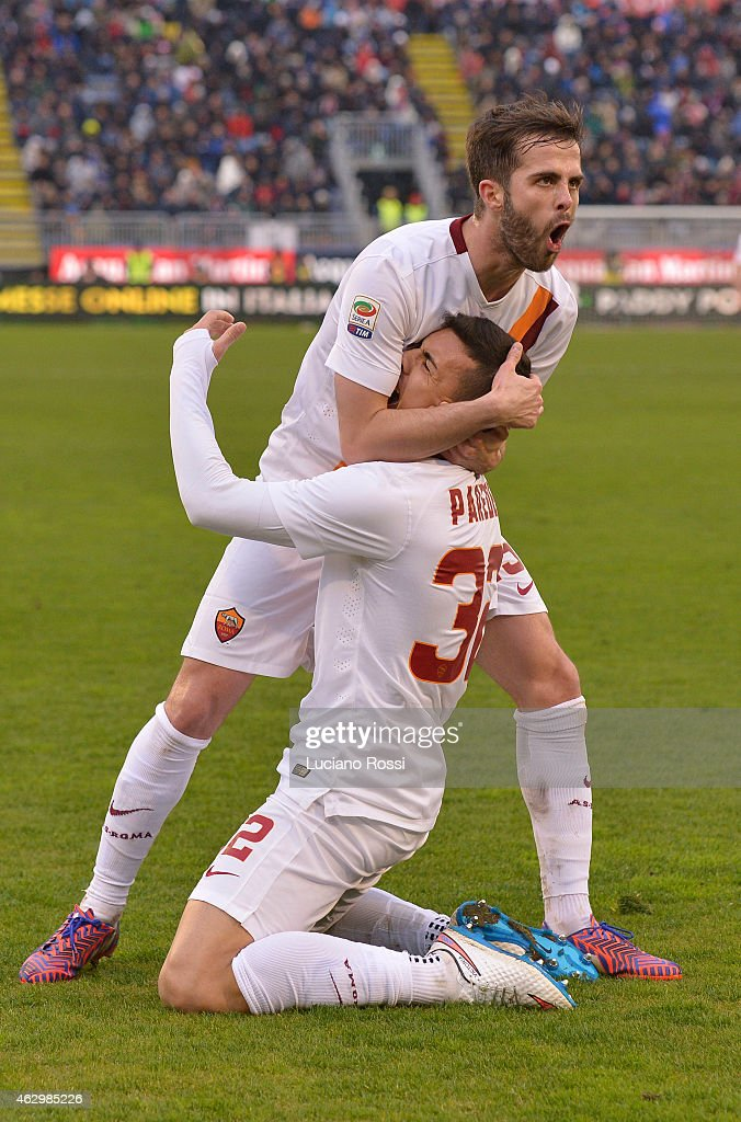 AS ROMA player <a gi-track='captionPersonalityLinkClicked' href=/galleries/search?phrase=Leandro+Paredes&family=editorial&specificpeople=7626324 ng-click='$event.stopPropagation()'>Leandro Paredes</a> celebrates with <a gi-track='captionPersonalityLinkClicked' href=/galleries/search?phrase=Miralem+Pjanic&family=editorial&specificpeople=4586190 ng-click='$event.stopPropagation()'>Miralem Pjanic</a> after scoring the goal during the Serie A match between Cagliari Calcio and AS Roma at Stadio Sant'Elia on February 8, 2015 in Cagliari, Italy.