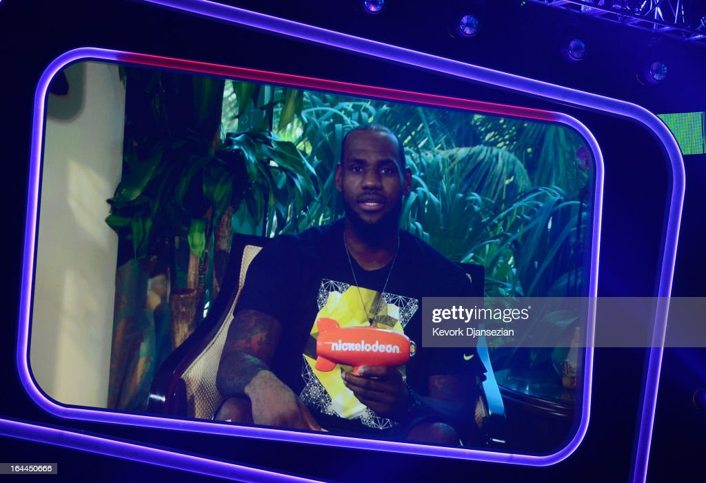 NBA player <a gi-track='captionPersonalityLinkClicked' href=/galleries/search?phrase=LeBron+James&family=editorial&specificpeople=201474 ng-click='$event.stopPropagation()'>LeBron James</a> accepts Favorite Male Athlete award via video during Nickelodeon's 26th Annual Kids' Choice Awards at USC Galen Center on March 23, 2013 in Los Angeles, California.