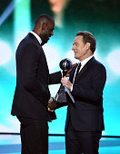 NBA player LeBron James accepts the award for Best Team from actor Bryan Cranston onstage during the 2016 ESPYS at Microsoft Theater on July 13 2016...