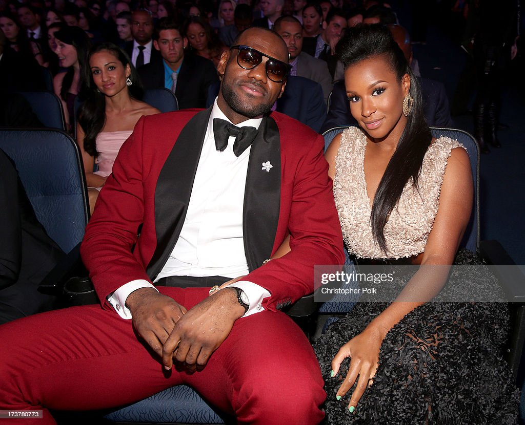 NBA player <a gi-track='captionPersonalityLinkClicked' href=/galleries/search?phrase=LeBron+James&family=editorial&specificpeople=201474 ng-click='$event.stopPropagation()'>LeBron James</a> (L) and <a gi-track='captionPersonalityLinkClicked' href=/galleries/search?phrase=Savannah+Brinson&family=editorial&specificpeople=4319994 ng-click='$event.stopPropagation()'>Savannah Brinson</a> attend The 2013 ESPY Awards at Nokia Theatre L.A. Live on July 17, 2013 in Los Angeles, California.