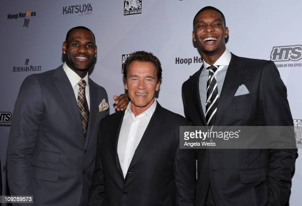 NBA player LeBron James former California Governor Arnold Schwarzenegger and NBA player Chris Bosh arrive at the AfterSchool All Stars Hoop Heroes...