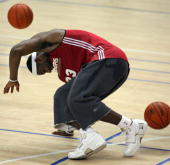 NBA player LeBron James of the Cleveland Cavaliers stumbles during a training session in the leadup to their 17 October exhibition match against the...