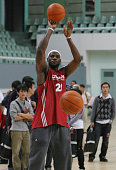 NBA player LeBron James of the Cleveland Cavaliers takes a shot during a training session before their 17 October exhibition match against the...