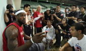 NBA player LeBron James of the Cleveland Cavaliers talks with members of Chinese media after a training session in the leadup to their 17 October...