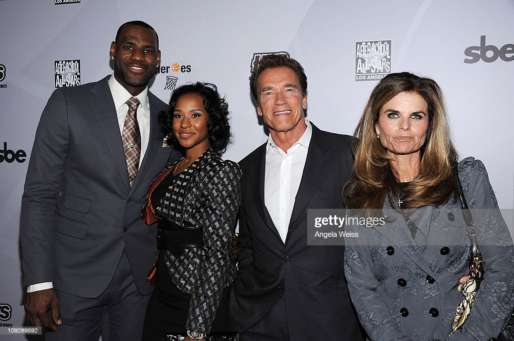 NBA player LeBron James Savannah Brinson former California Governor Arnold Schwarzenegger and Maria Shriver arrive at the AfterSchool All Stars Hoop...