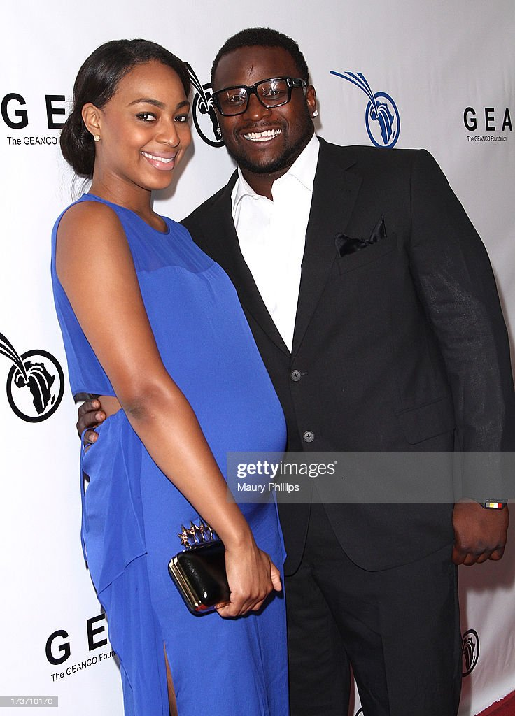 Player LeRon McClain (R) and Dominque Wade arrive at The GEANCO Foundation's 'Impact Africa' Fundraiser at Bootsy Bellows on July 16, 2013 in West Hollywood, California.