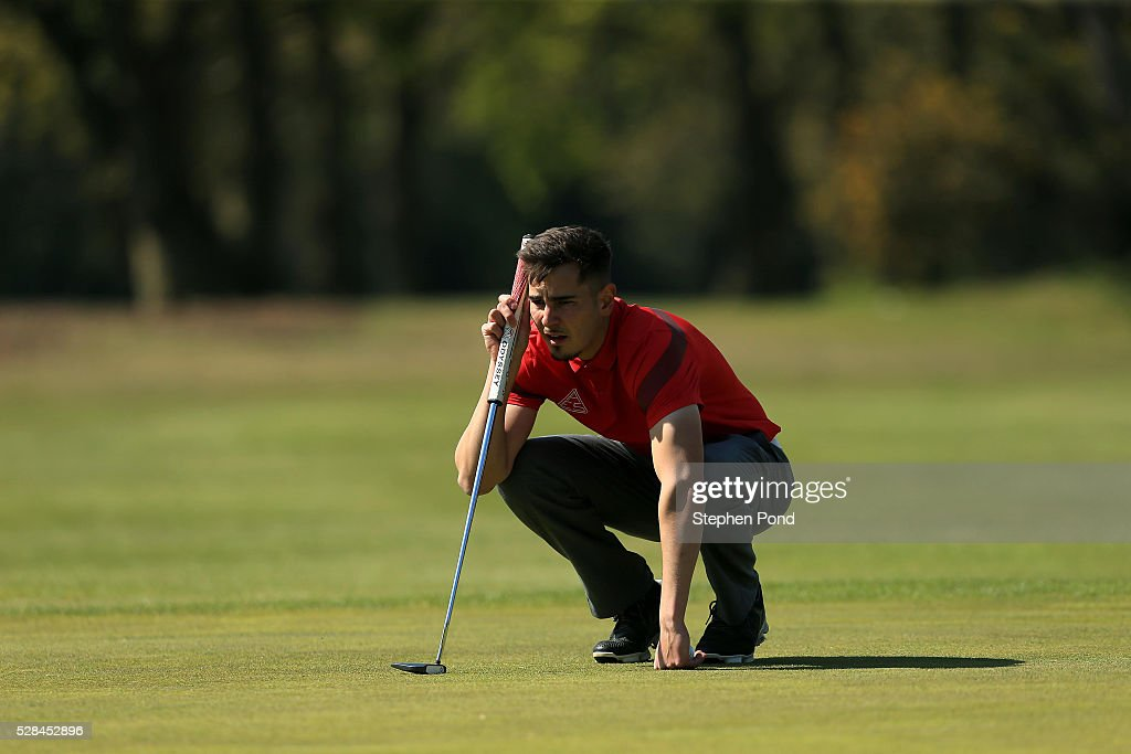 A player lines up his putt on a green during the PGA Assistants Championship East Qualifier at Ipswich Golf Club on May 5, 2016 in Ipswich, England.