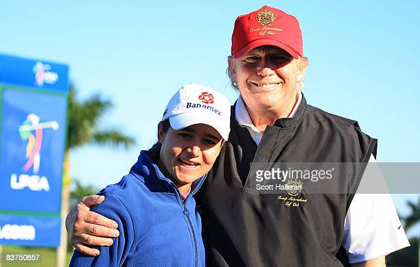 LPGA player Lorena Ochoa poses with tournament host Donald Trump prior to the start of the ADT Championship at the Trump International Golf Club on...