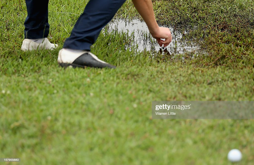A player marks his ball during the first round of The Nelson Mandela Championship presented by ISPS Handa at Royal Durban Golf Club on December 8, 2012 in Durban, South Africa.