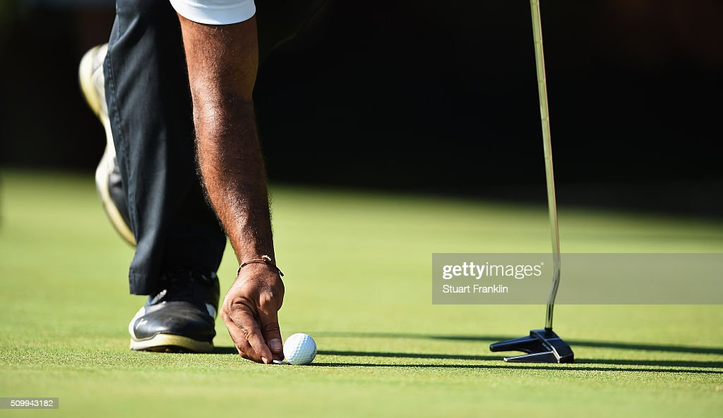 A player marks his golf ball during the third round of the Tshwane Open at Pretoria Country Club on February 13, 2016 in Pretoria, South Africa.