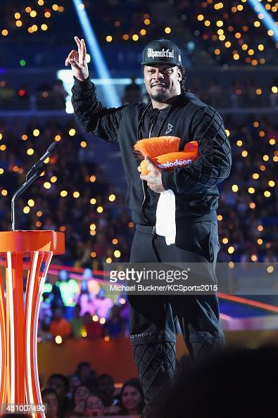 NFL player Marshawn Lynch accepts the award for 'Biggest Powerhouse' onstage at the Nickelodeon Kids' Choice Sports Awards 2015 at UCLA's Pauley...