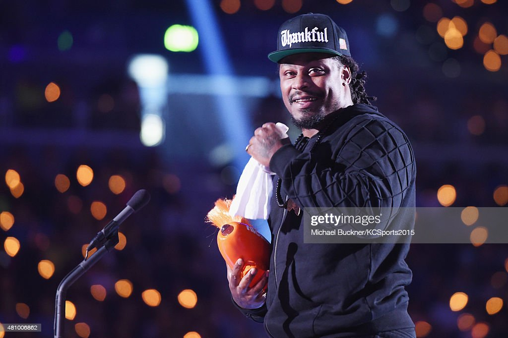 NFL player Marshawn Lynch accepts the Biggest Powerhouse award onstage at the Nickelodeon Kids' Choice Sports Awards 2015 at UCLA's Pauley Pavilion on July 16, 2015 in Westwood, California.