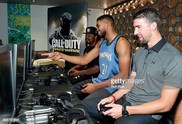 NFL player Marshawn Lynch NBA player KarlAnthony Towns and Olympic swimmer Michael Phelps attend The Ultimate Fan Experience Call Of Duty XP 2016...