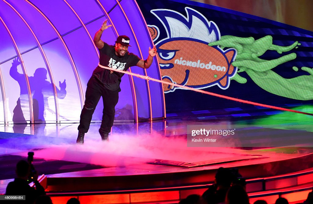 NFL player Marshawn Lynch plays tug of war onstage at the Nickelodeon Kids' Choice Sports Awards 2015 at UCLA's Pauley Pavilion on July 16, 2015 in Westwood, California.