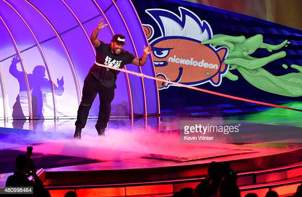 NFL player Marshawn Lynch plays tug of war onstage at the Nickelodeon Kids' Choice Sports Awards 2015 at UCLA's Pauley Pavilion on July 16 2015 in...