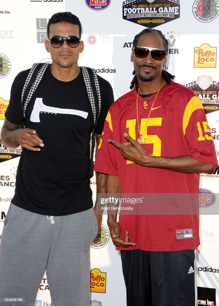 NBA player Matt Barnes (L) and rapper Snoop Dogg attend the 2nd Annual Celebrity Flag Football Game benefiting Athletes VS. Cancer at Granada Hills Charter High School on September 7, 2014 in Granada Hills, California.