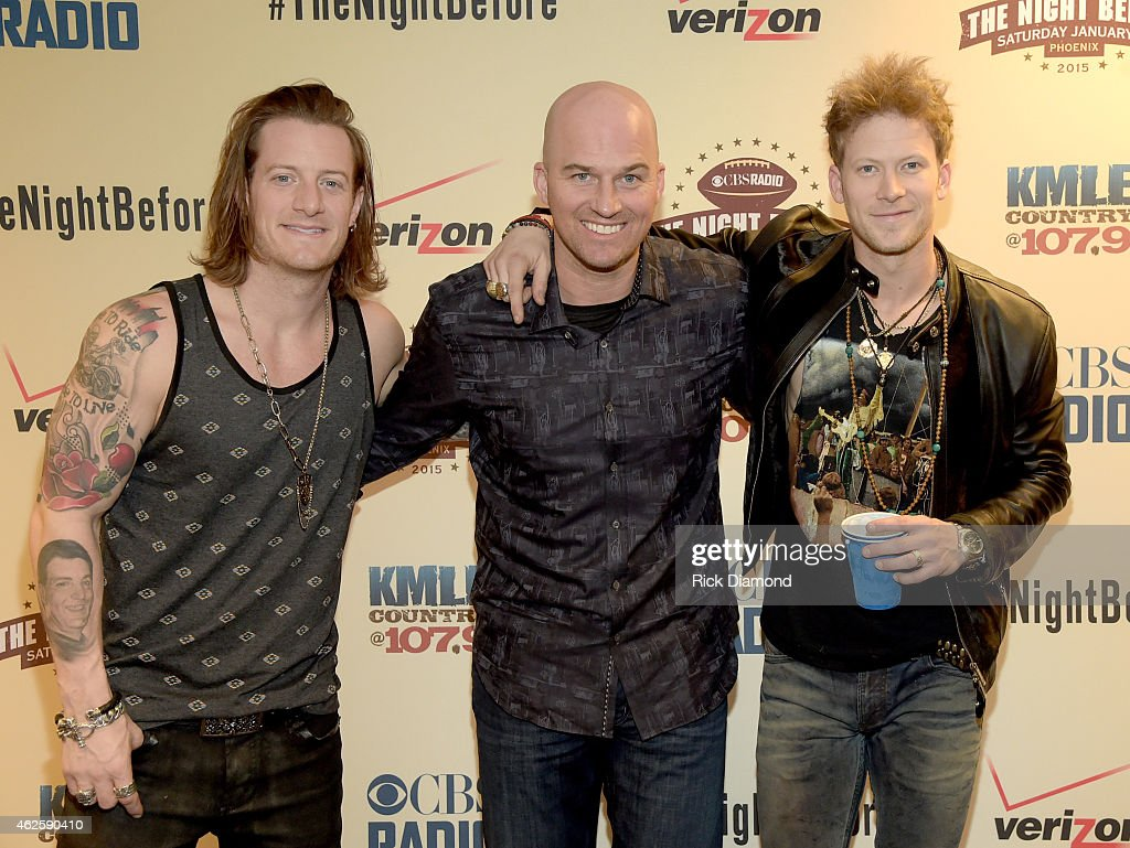 NFL player Matt Hasselbeck poses with musicians Tyler Hubbard and Brian Kelley of Florida Georgia Line backstage during CBS Radio's The Night Before...