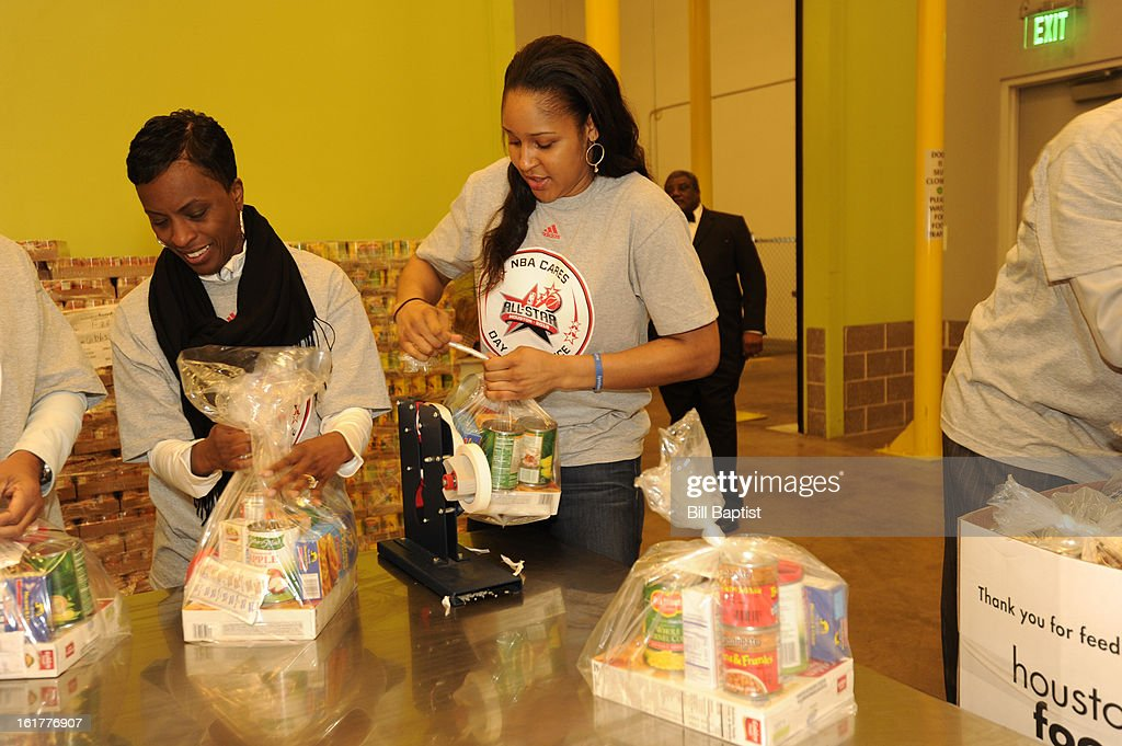 WNBA player Maya Moore of the Minnesota Lynx helps out at the 2013 NBA Cares Day of Service at the Food Bank sorting on February 15, 2013 in Houston, Texas.