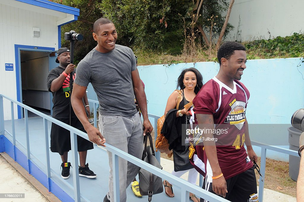 NBA player Metta World Peace (2nd from L) attends the First Annual Celebrity Flag Football Game on August 18, 2013 in Pacific Palisades, California.