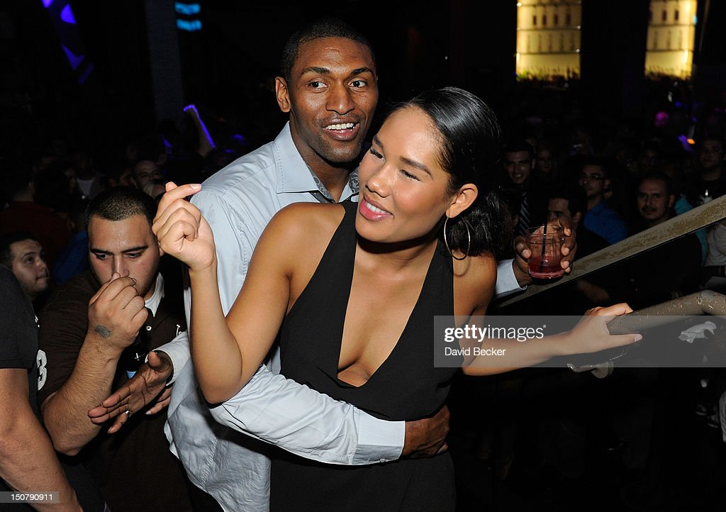 NBA player Metta World Peace, (L) formerly known as <a gi-track='captionPersonalityLinkClicked' href=/galleries/search?phrase=Ron+Artest&family=editorial&specificpeople=201763 ng-click='$event.stopPropagation()'>Ron Artest</a>, appears with Maya Hirata at Chateau Nightclub & Gardens at the Paris Las Vegas on August 25, 2012 in Las Vegas, Nevada.