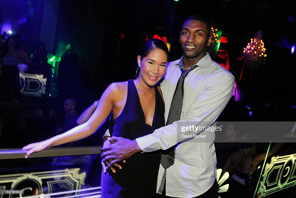 NBA player Metta World Peace, (R) formerly known as <a gi-track='captionPersonalityLinkClicked' href=/galleries/search?phrase=Ron+Artest&family=editorial&specificpeople=201763 ng-click='$event.stopPropagation()'>Ron Artest</a>, appears with Maya Hirata at Chateau Nightclub & Gardens at the Paris Las Vegas on August 25, 2012 in Las Vegas, Nevada.
