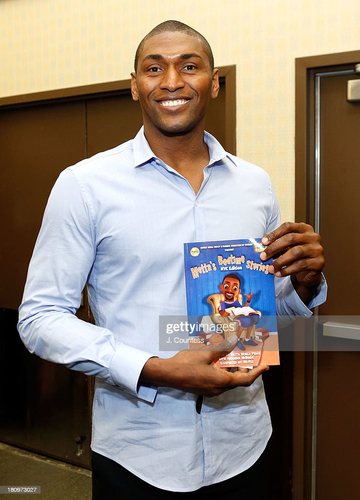 NBA player Metta World Peace holds a copy of his children's book 'Metta's Bedtime Stories' during an instore signing at Barnes & Noble Tribeca on September 18, 2013 in New York City.