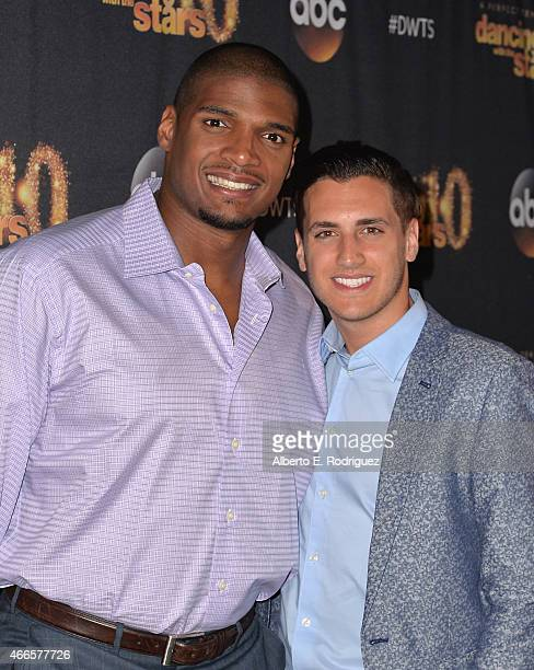 NFL player Michael Sam and fiance` Vito Cammisano attend the premiere of ABC's 'Dancing With The Stars' season 20 at HYDE Sunset Kitchen Cocktails on...