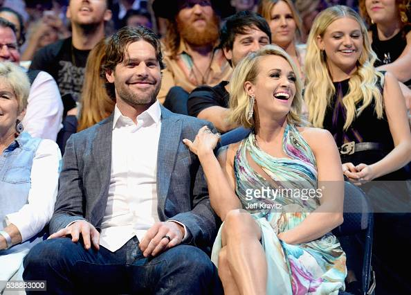 NHL player Mike Fisher and musician Carrie Underwood attend the 2016 CMT Music awards at the Bridgestone Arena on June 8 2016 in Nashville Tennessee