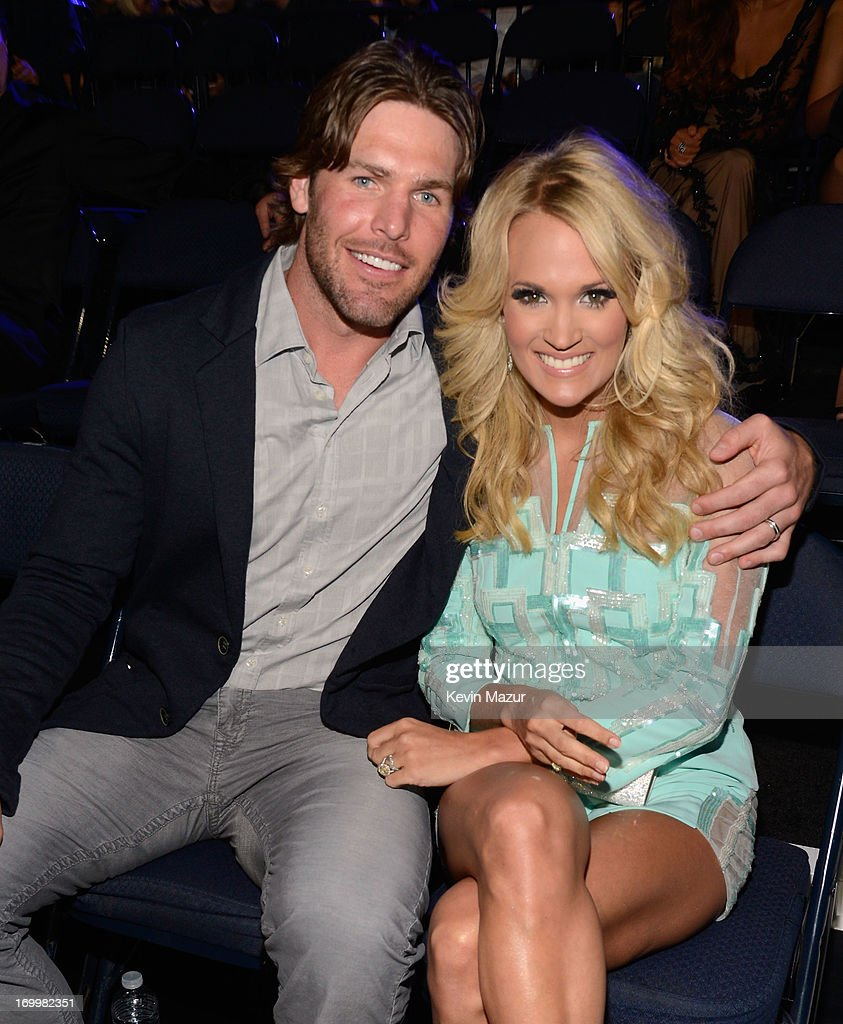NHL player <a gi-track='captionPersonalityLinkClicked' href=/galleries/search?phrase=Mike+Fisher+-+Ice+Hockey+Player&family=editorial&specificpeople=204732 ng-click='$event.stopPropagation()'>Mike Fisher</a> (L) and singer <a gi-track='captionPersonalityLinkClicked' href=/galleries/search?phrase=Carrie+Underwood&family=editorial&specificpeople=204483 ng-click='$event.stopPropagation()'>Carrie Underwood</a> attend the 2013 CMT Music awards at the Bridgestone Arena on June 5, 2013 in Nashville, Tennessee.