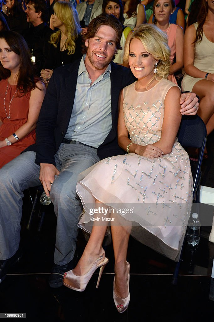 NHL player Mike Fisher (L) and singer Carrie Underwood attend the 2013 CMT Music awards at the Bridgestone Arena on June 5, 2013 in Nashville, Tennessee.