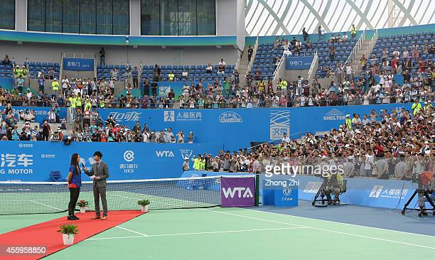 WTA player Na Li of China during her Retirement Ceremony on day three of 2014 Dongfeng Motor Wuhan Open at Optics Valley International Tennis Center...