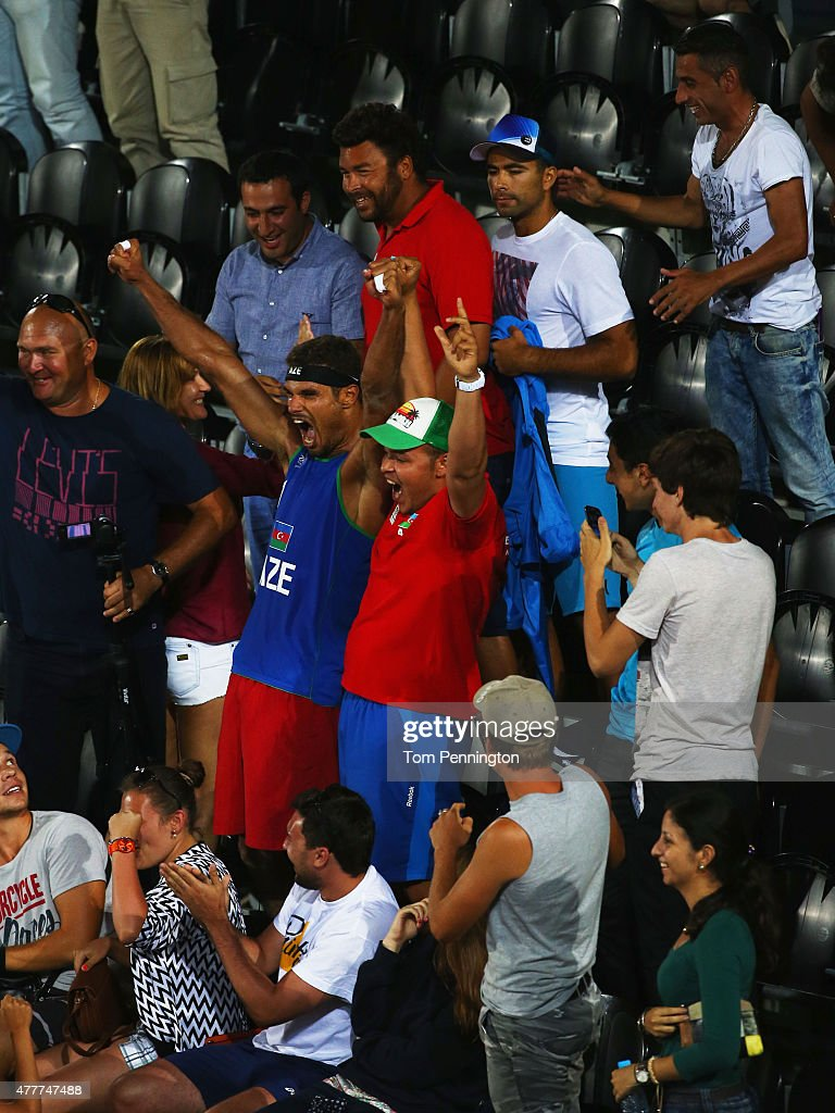 Player Neilton Santos of Azerbaijan celebrates victory in the stands with spectators during the Men's Beach Volleyball elimination round match...