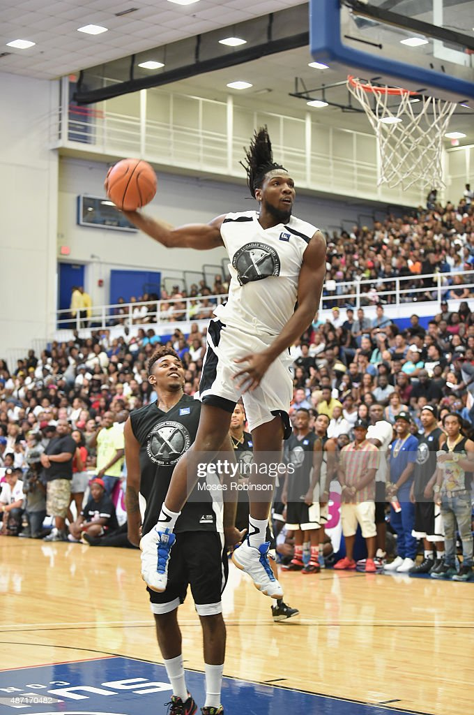 NBA player Nenê Hilario going up for a dunk at LudaDay Weekend Annual Celebrity Basketball Game at Georgia State University Sports Arena on September 6, 2015 in Atlanta, Georgia.