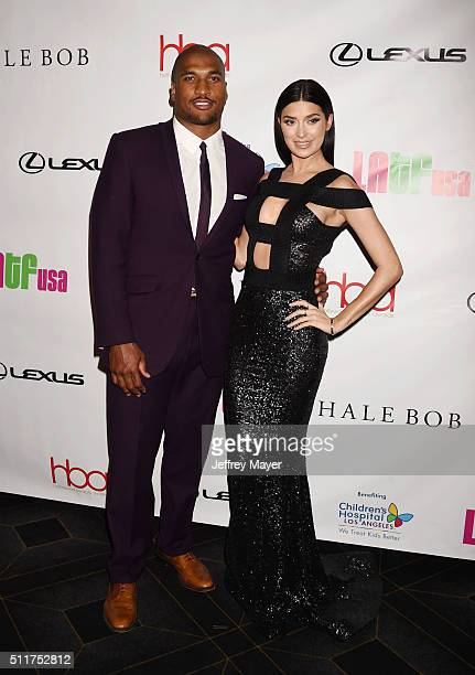NFL player NFL player Larry English and TV personality Nicole Williams attend the 2nd Annual Hollywood Beauty Awards benefiting Children's Hospital...