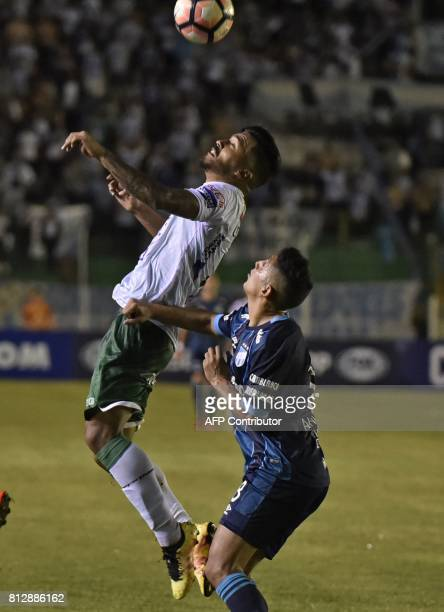 Player Nicolas Roman of Oriente Petrolero of Bolivia vies for the ball with Rodrigo Aliendro of Atletico Tucuman of Argentina during their...