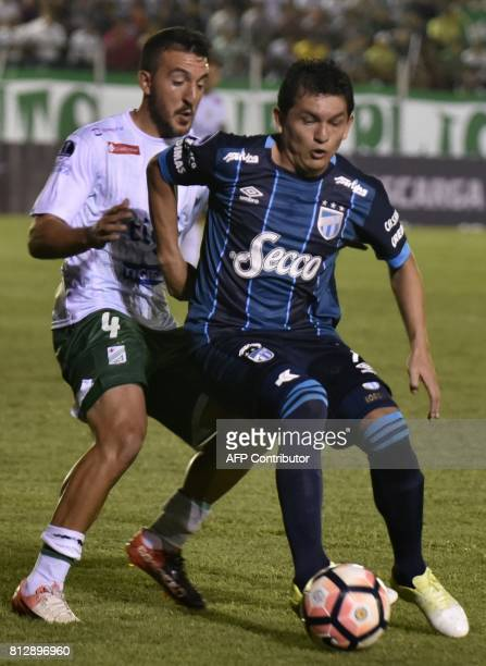 Player Nicolas Roman of Oriente Petrolero of Bolivia vies for the ball with Luis Miguel Rodriguez of Atletico Tucuman of Argentina during their...