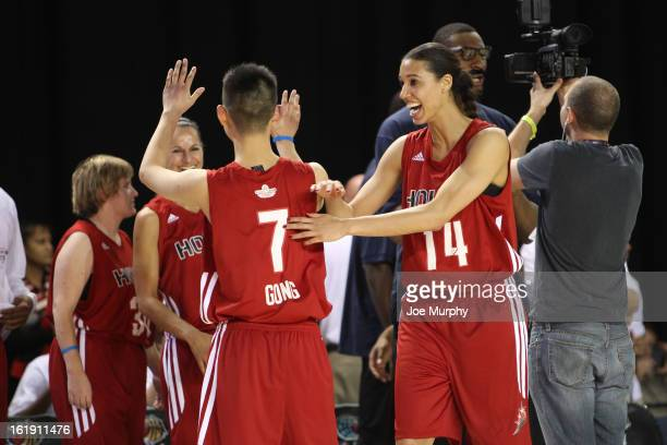 WNBA player Nicole Powell celebrates with her team during the NBA Cares Special Olympics Unity Sports Basketball Game on Center Court during the 2013...