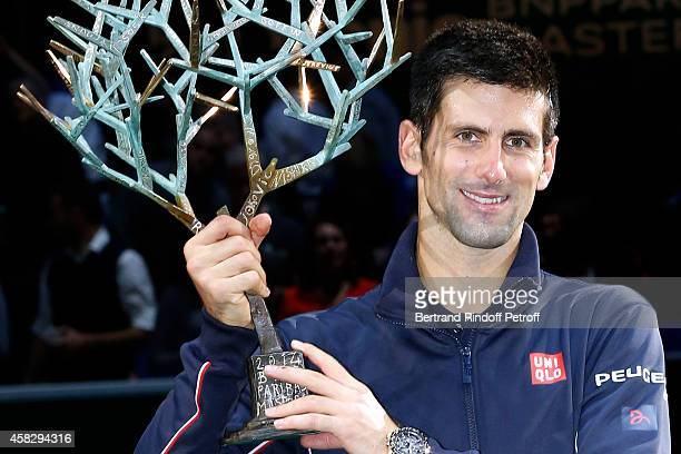 Player Novak Djokovic and his Trophy after he won the Final match during day 7 of the BNP Paribas Masters Held at Palais Omnisports de Bercy on...