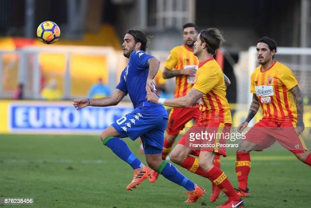 Player of Benevento Calcio Andrea Costa vies with US Sassuolo player Alessandro Matri during the Serie A match between Benevento Calcio and US...