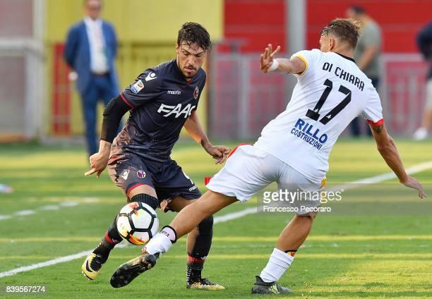 Player of Benevento Calcio Gianluca Di Chiara vies with Bologna FC player Simone Verdi during the Serie A match between Benevento Calcio and Bologna...