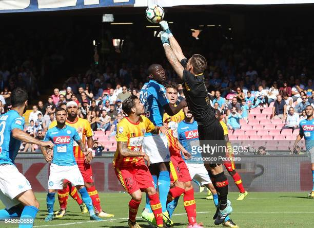 Player of Benevento Calcio Vid Belec vies with SSC Napoli player Kalidou Koulibaly during the Serie A match between SSC Napoli and Benevento Calcio...