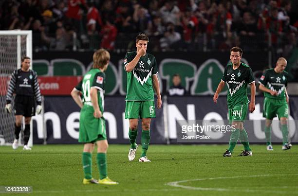 Player of Bremen are seen after Hannover scored the second goal during the Bundesliga match between Hannover 96 and SV Werder Bremen at AWD Arena on...