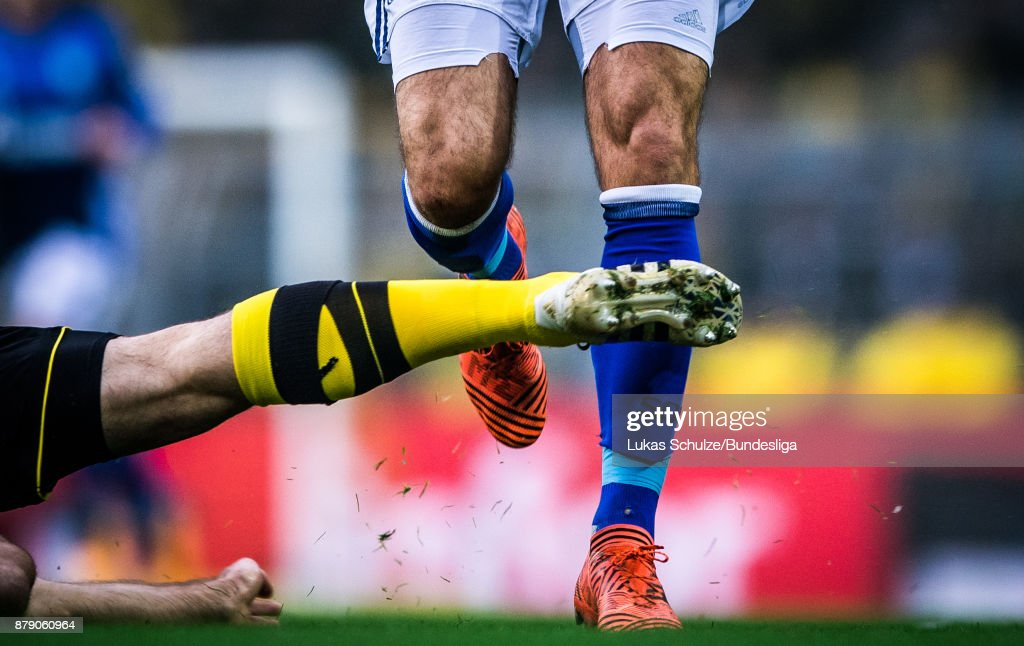 A player of Dortmund attacks a player of Schalke during the Bundesliga match between Borussia Dortmund and FC Schalke 04 at Signal Iduna Park on November 25, 2017 in Dortmund, Germany.