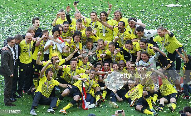 Player of Dortmund celebrate with the trophy winning the German Championship after the Bundesliga match between Borussia Dortmund and Eintracht...