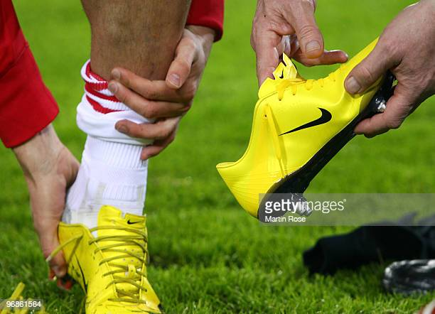 A player of Eindhoven changes football boots prior to the UEFA Europa League knockout round first leg match between Hamburger SV and PSV Eindhoven at...