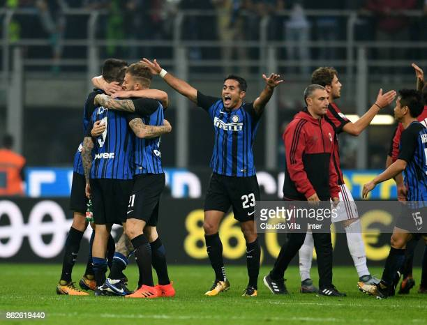 Player of FC Internazionale celebrate at the end of the Serie A match between FC Internazionale and AC Milan at Stadio Giuseppe Meazza on October 15...
